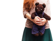 Girl hugging her favorite teddy bear Royalty Free Stock Image