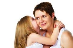 Girl hugging her mother Stock Photo