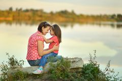 girl hugging her mother Stock Photography
