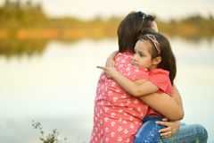 Girl hugging her mother Royalty Free Stock Images