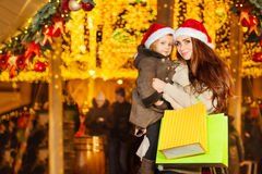 Girl hugging her mother over holiday background Stock Images