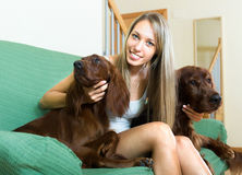 Girl hugging her purebred dogs Royalty Free Stock Images