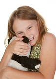 Girl hugging her teddy bear Royalty Free Stock Image