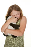 Girl hugging her teddy bear Stock Photo