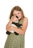 Girl hugging her teddy bear Royalty Free Stock Images