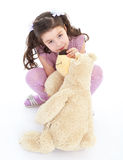 Girl hugging her teddy bear. Royalty Free Stock Images
