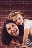 Girl Hugging Laughing Mother Royalty Free Stock Photos
