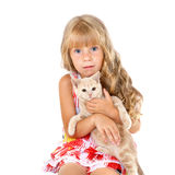 Girl hugging a little cat. Cute sad girl hugging a little cat isolated on white background royalty free stock image