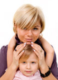 Girl hugging a mother Stock Photos