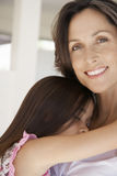 Girl Hugging Mother At Home Stock Images