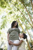 Girl Hugging Mother In Park Royalty Free Stock Photos