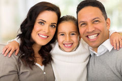 Girl hugging parents Stock Photos