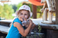 Girl hugging a pet cat, sphynx on veranda house Royalty Free Stock Images