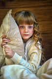Girl hugging a pillow Stock Photography