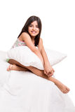 Girl hugging pillow Royalty Free Stock Photography