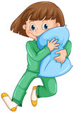 Girl hugging pillow at slumber party Royalty Free Stock Images