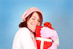 Girl hugging the present Stock Photo