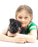 Girl hugging puppy Stock Photo