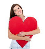 Girl hugging red heart Stock Photography