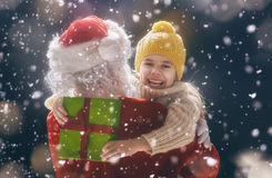 Girl hugging Santa Stock Photos