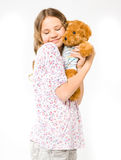 Girl hugging a teddy bear Royalty Free Stock Photography