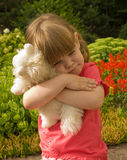 The girl hugging a toy Stock Photo