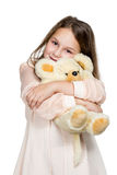 Girl hugging a toy bear Royalty Free Stock Image