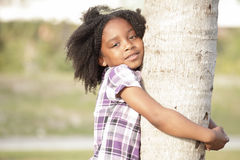 Girl hugging a tree Royalty Free Stock Photography