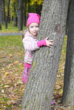 Girl hugging a tree Royalty Free Stock Image