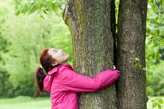 Girl hugging tree Royalty Free Stock Image