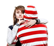 Girl hugging a young man in the hood. Portrait of a girl hugging a young men in the hood Royalty Free Stock Images