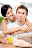 Girl hugs eating boyfriend Stock Photography