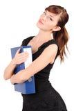 Girl hugs folder isolated. Girl in black hugs large blue folder isolated on white background stock photos
