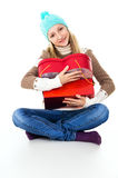 Girl hugs gifts in winter clothes isolated Stock Images