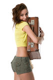 Girl hugs a suitcase with a smile Stock Photography