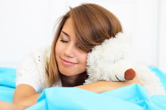 Girl hugs teddy bear Royalty Free Stock Images