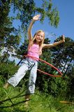 Girl  with hula hoop Royalty Free Stock Images