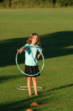 Girl with hula-hoop. Natural portrait of girl playing in park Stock Photography
