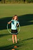 Girl with hula-hoop Stock Photography
