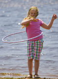 Girl With Hula Hoop on Beach Stock Photo