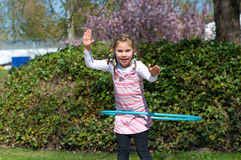 Girl with hula hoop Royalty Free Stock Photo