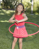 Girl and Hula Hoop Royalty Free Stock Photo