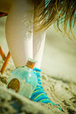 Girl hunched over a bottle Stock Photo