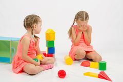 Girl hurt another girl playing with toys Stock Image
