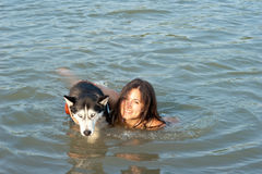 Girl with Husky dog Royalty Free Stock Photos