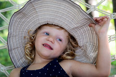 Girl with hut Royalty Free Stock Images