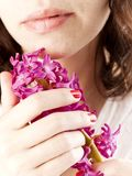 Girl with hyacinth Royalty Free Stock Photography