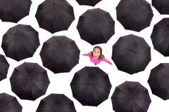Girl iamongst umbrellas Royalty Free Stock Images