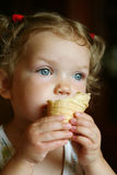 Girl with ice-cream Stock Images