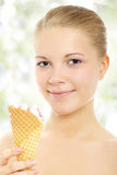Girl with ice cream. On a light background Royalty Free Stock Image